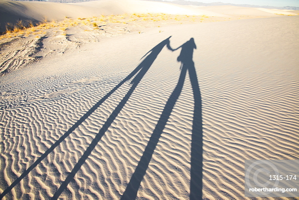 Two dorks playing with shadows in White Sands National Park, New Mexico