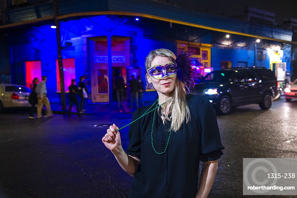 Woman ready to celebrate Mardis Gras on Frenchmen Street, the jazz district of New Orleans, Louisiana, United States of America, North America
