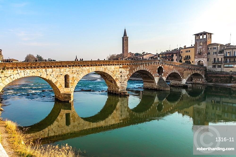 Panoramic view of Ponte Pietra bridge in Verona on Adige river, Veneto region, Italy