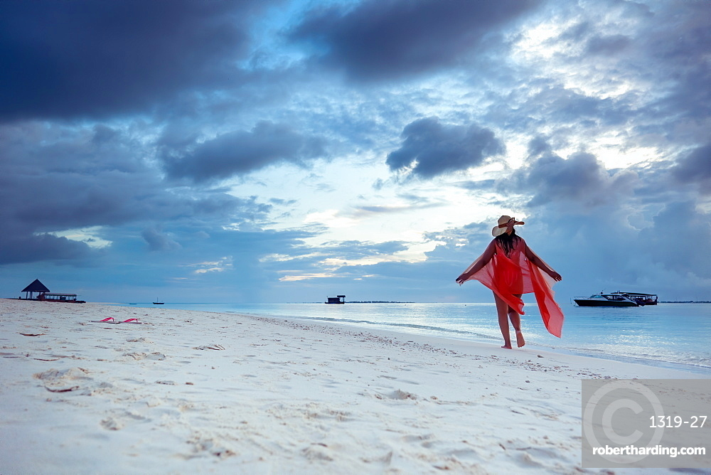 A woman enjoying the beach, The Maldives, Indian Ocean, Asia