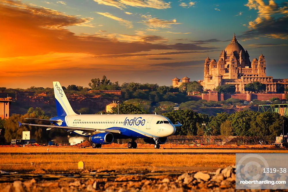 Indigo Airlines, Indian low cost carrier rolling out from Jodhpur Airport. Famous Umaid Bhawan Palace in backdrop.