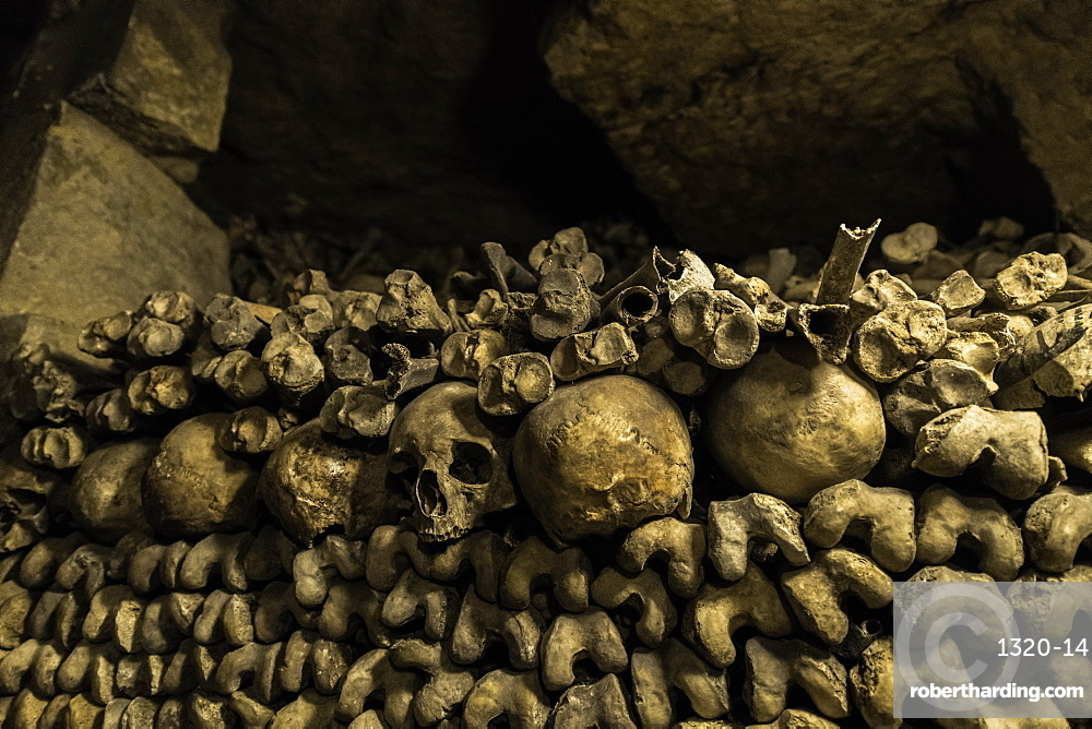 Skulls and bones that line the halls of the Catacombs, Paris, France, Europe