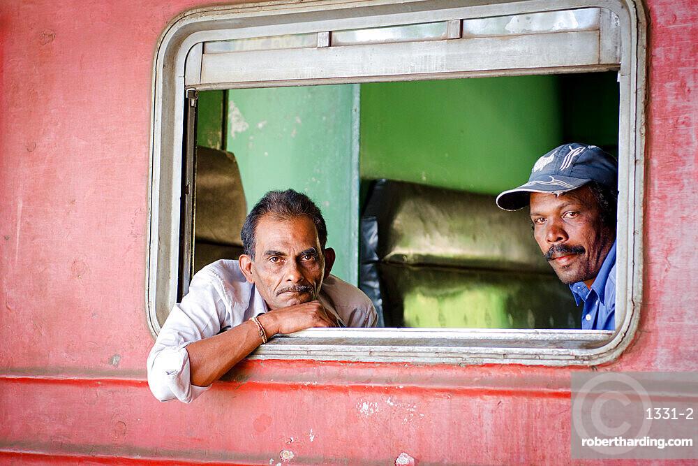 Two men on a train, Ella train station, Sri Lanka, Asia