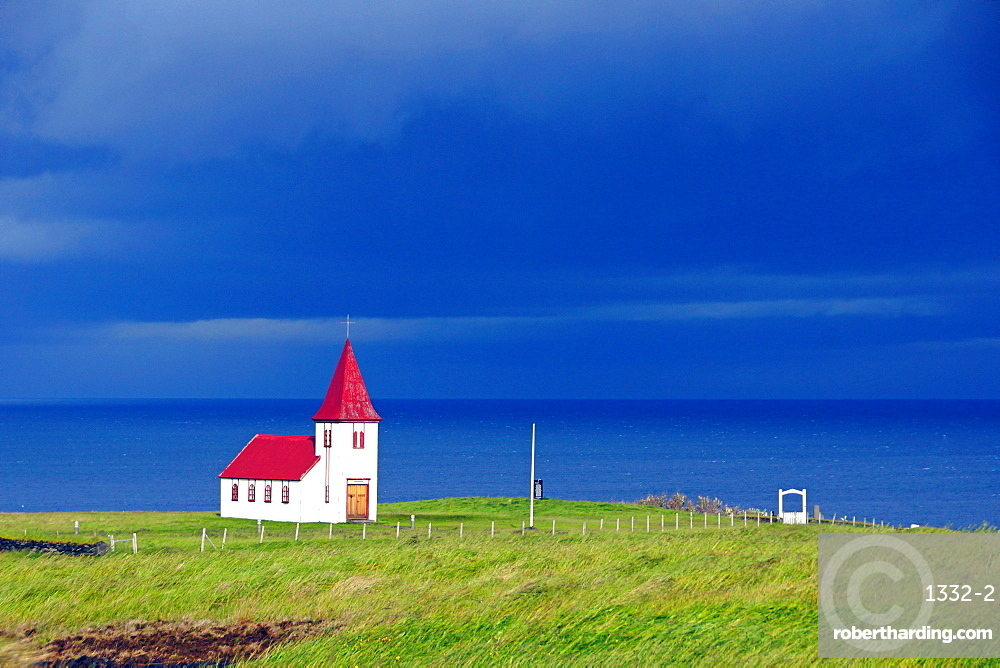 Red church by the sea