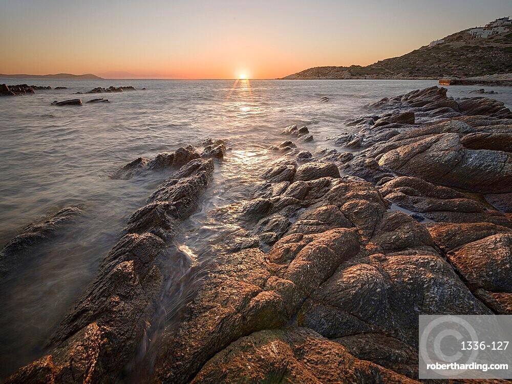 Sunset on the sea and rocks, Antiparos Island, Cyclades, Greek Islands, Greece, Europe