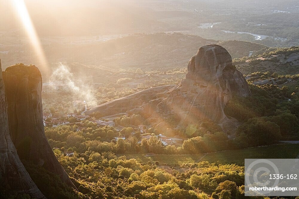 Sunset light and sun beams in the smoke in Meteora, Thessaly, Greece, Europe