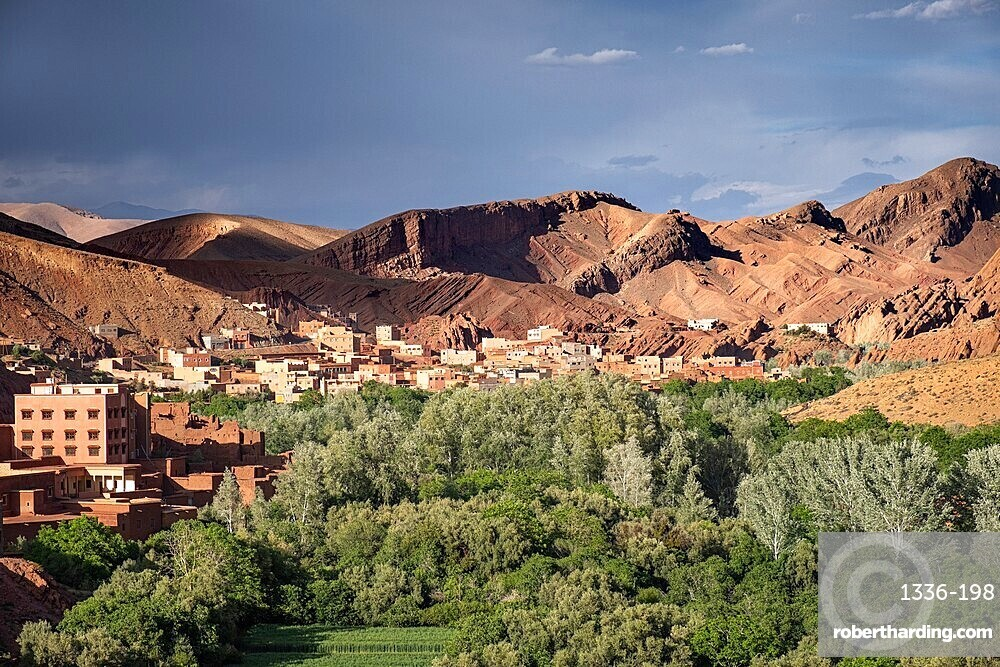 Village in a green oasis and beautiful light on the mountains in the background, Morocco, North Africa, Africa