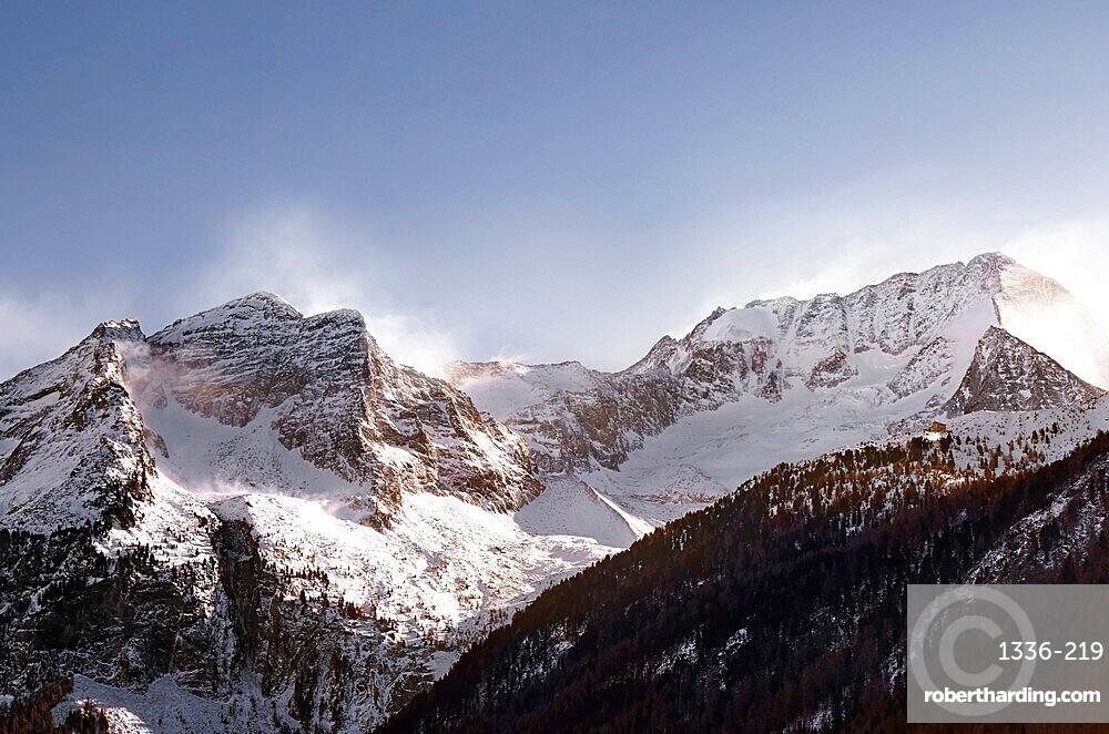 Wind gusting on Hochgall peak in winter, Trentino-Alto Adige, Italy, Europe