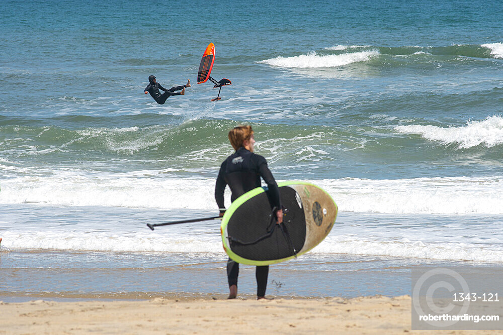 Pro surfer James Jenkins wipes out on his foiling surfboard at Nags Head, North Carolina, United States of America, North America