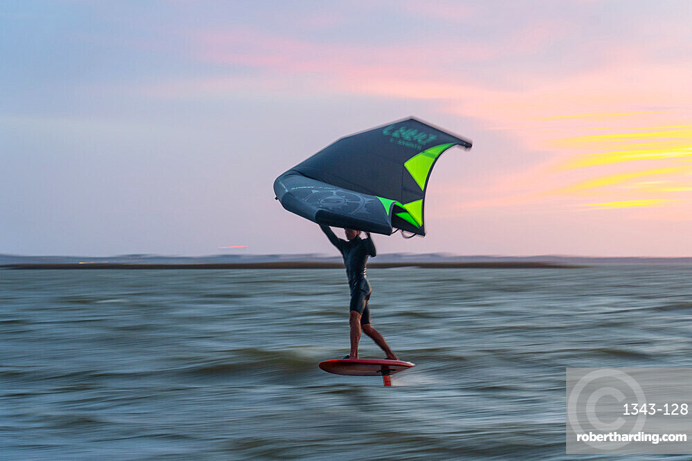 Pro surfer James Jenkins on his wing surfer flies across the Pamlico Sound at Nags Head, North Carolina, United States of America, North America