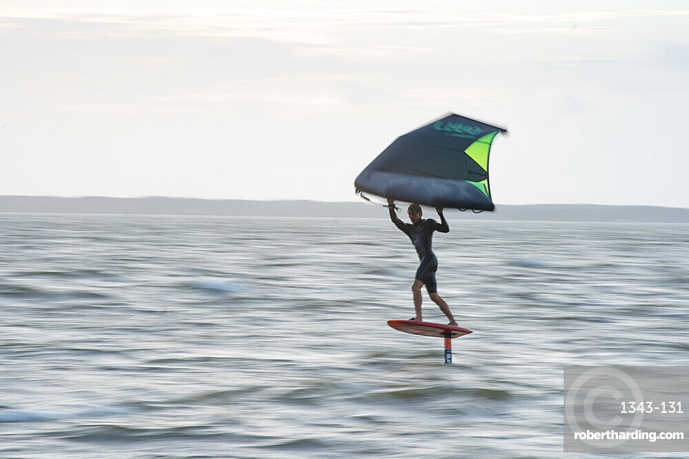 Pro surfer James Jenkins flies above the Atlantic Ocean on his wing surfer at Nags Head, North Carolina, United States of America, North America