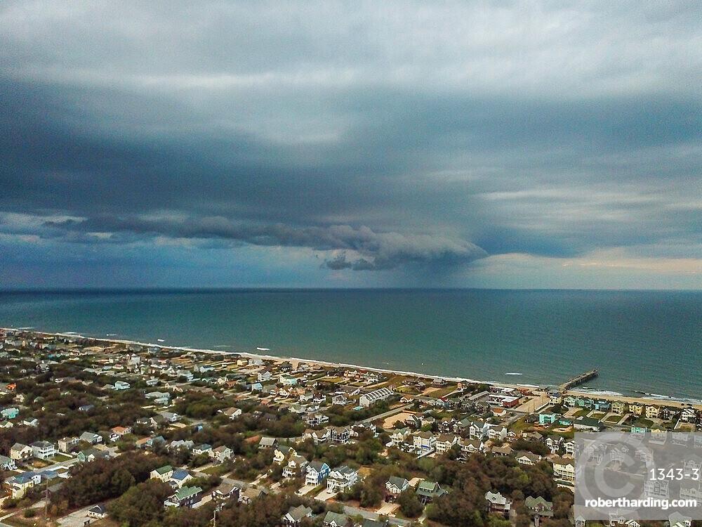 Rain squall moves across the Atlantic Ocean offshore of Nags Head, North Carolina, United States of America, North America