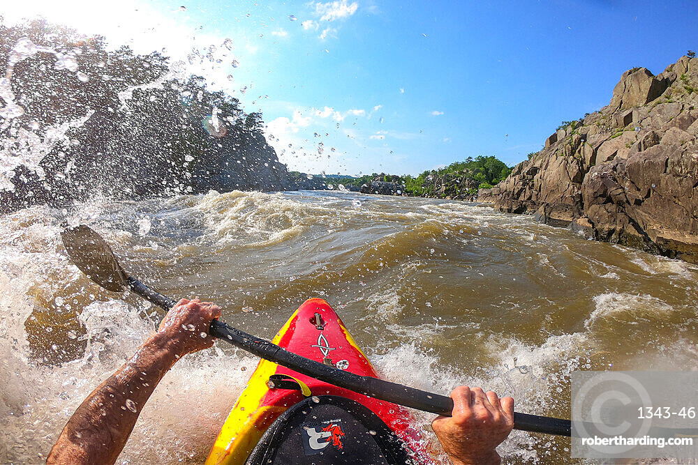Photographer Skip Brown surfs his kayak on a whitewater wave on the Potomac River, border of Virginia and Maryland, United States of America, North America