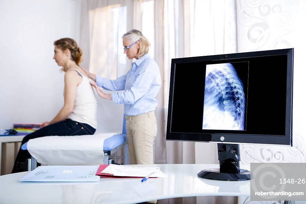 Doctor examining patient's back.