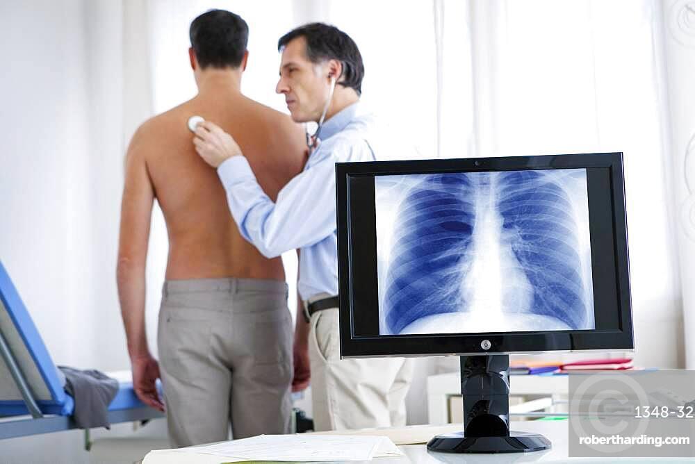 Doctor auscultating a patient.