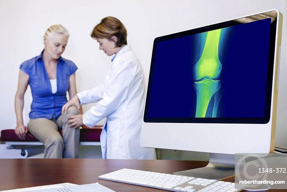 Doctor examining patient's knee.