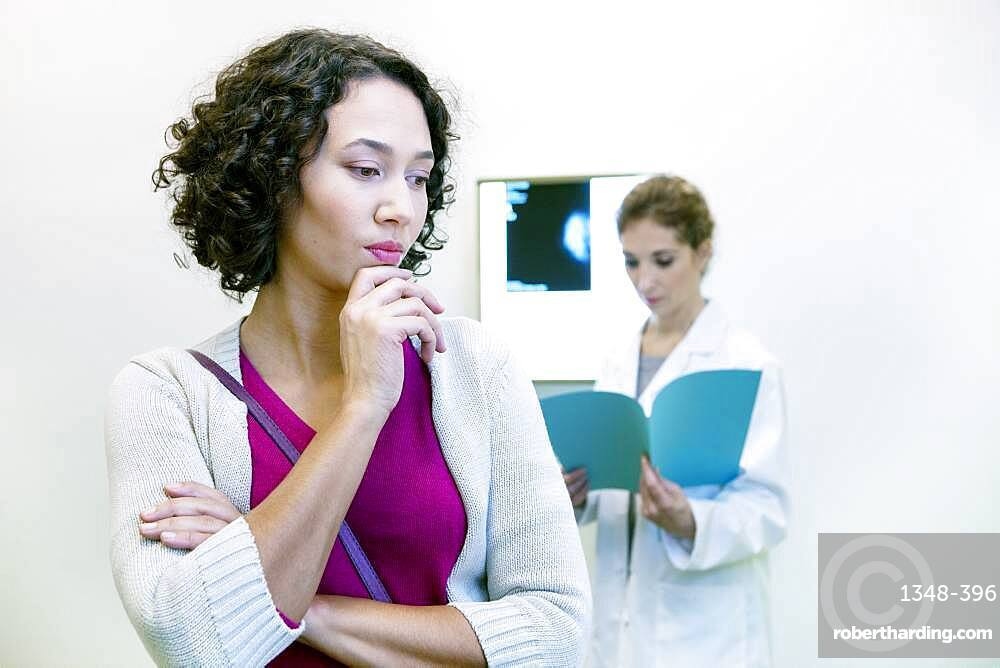 Doctor explaining to a patient the result of her mammogram.