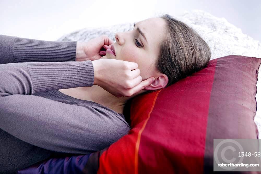 Woman suffering from earache.
