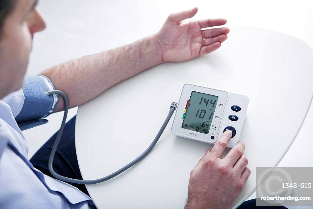 Man measuring his blood pressure.