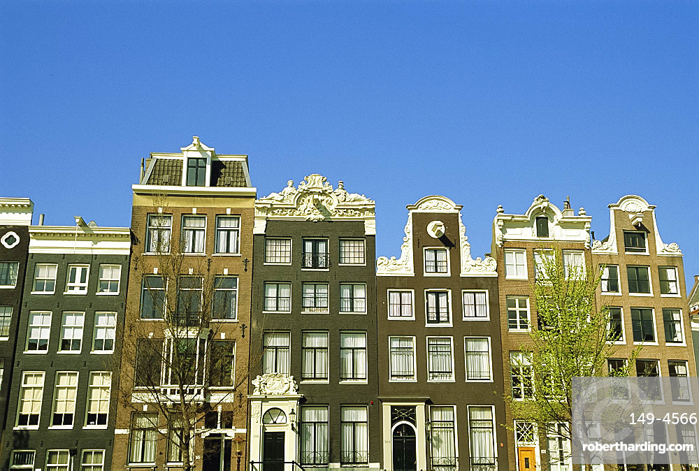 Old merchant houses on the canal in Amsterdam, Holland, The Netherlands