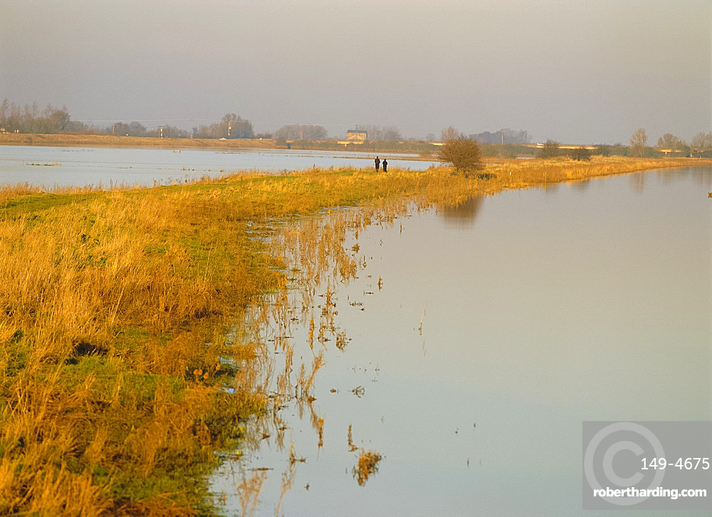 Walkers on The Fens in November, Norfolk, England