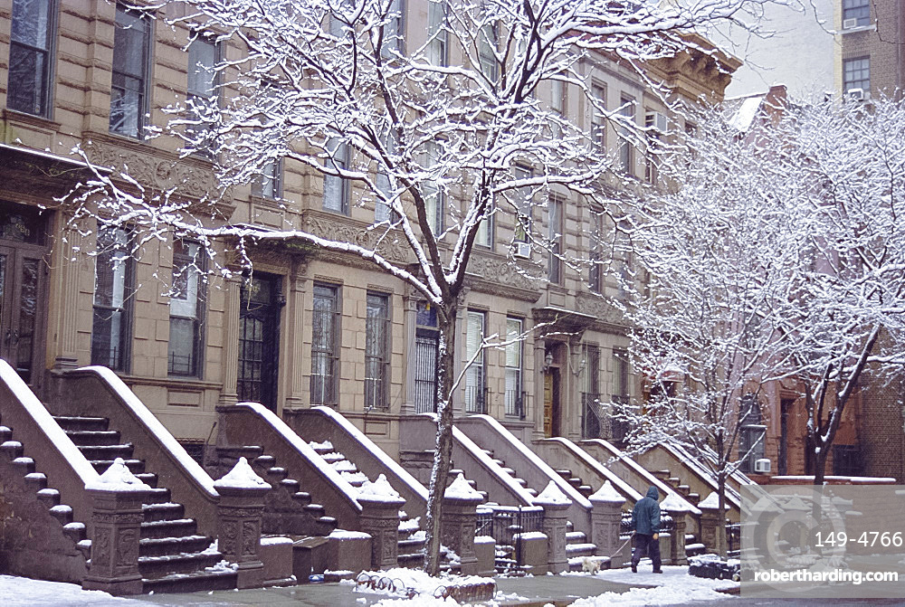Old brownstone style houses after a snowstorm, New York City, New York, USA