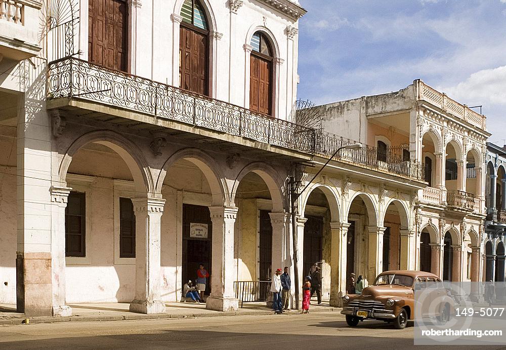 A vintage American car coming along Avenida Reina in central Havana, Cuba, West Indies, Central America