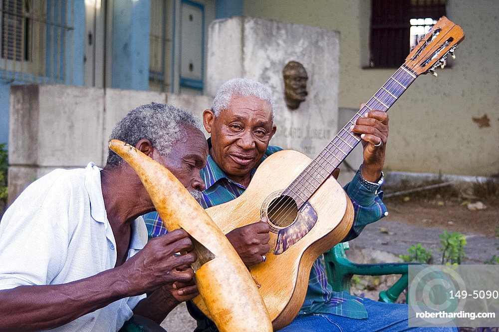 Musicians playing on the street in Santiago de Cuba, Cuba, West Indies, Central America