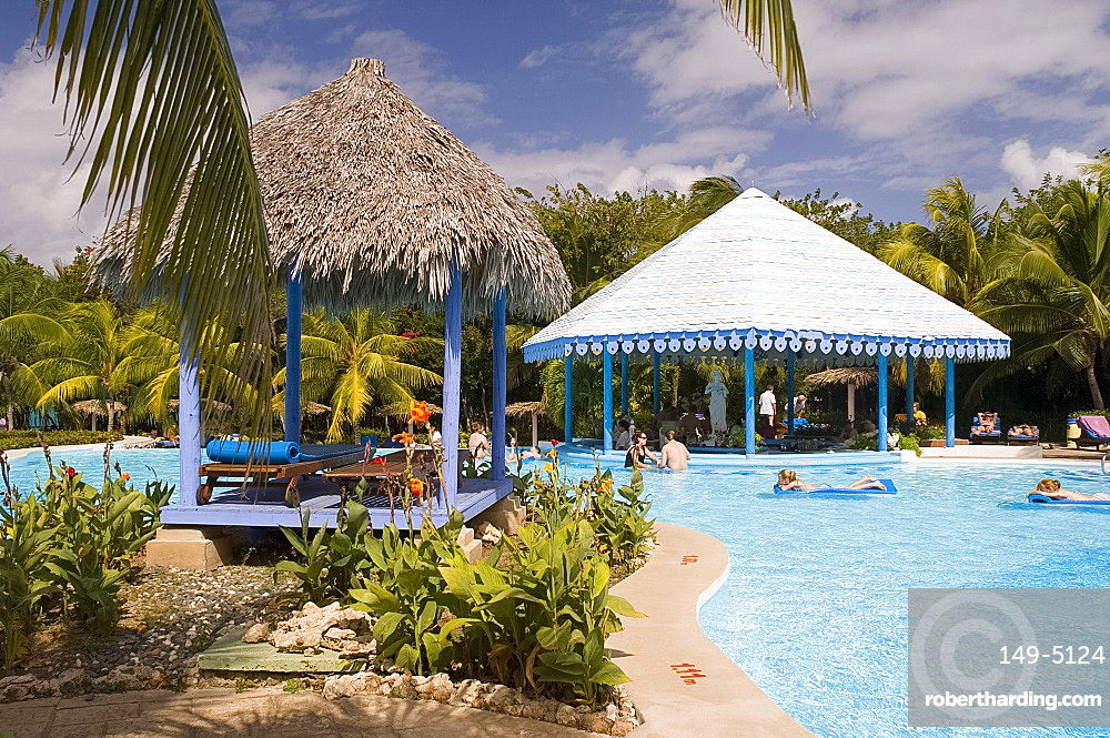 Swimmers in the pool at the Hotel Melia Rio de Oro on the Playa Esmeralda, Carretera Guardalavaca, Eastern Cuba, Cuba, West Indies, Central America