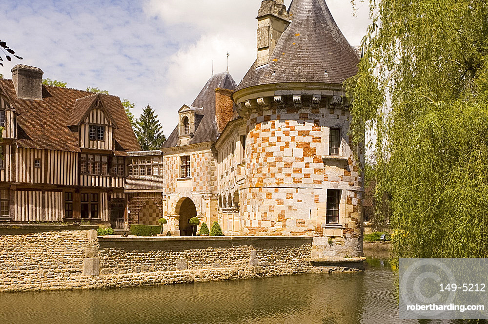 The chateau of St.-Germanine-de-Livet with a colourful checked facade and half timbered 15th century wing, Normandy, France, Europe