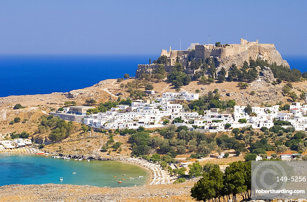 Typical Dodecanese white houses and the Acropolis above Lindos, Rhodes, Dodecanese Islands, Greek Islands, Greece, Europe