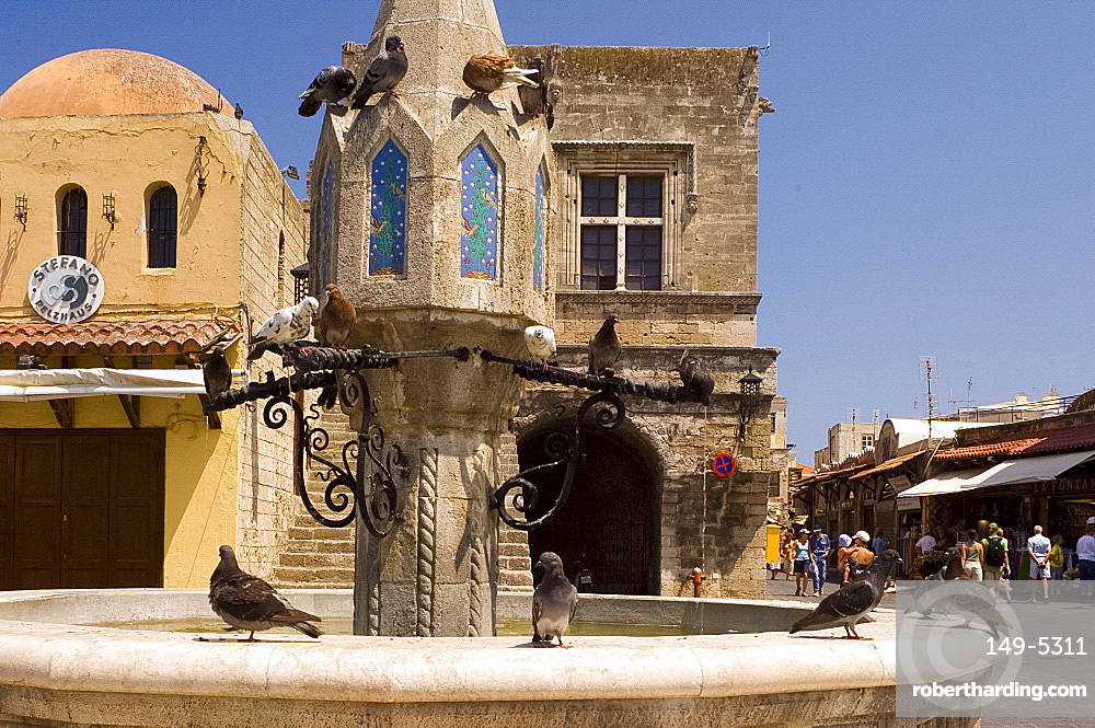 Pigeons on a fountain in Rhodes Town, Rhodes, Dodecanese, Greek Islands, Greece, Europe