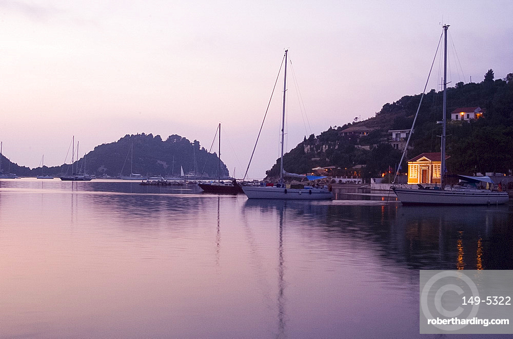 The harbour at Lakka at dusk, Paxos, Ionian Islands, Greek Islands, Greece, Europe