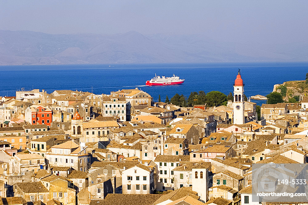 Aerial view of Corfu Old Town and St. Spyridonas belltower from the New Fort, with ferry in the Ionian Sea, Corfu, Ionian Islands, Greek Islands, Greece, Europe