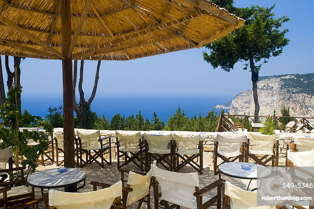 The Sunset Bar on the west coast of Paxos overlooking the dramatic Ermitis Cliffs, Paxos, Ionian Islands, Greek Islands, Greece, Europe