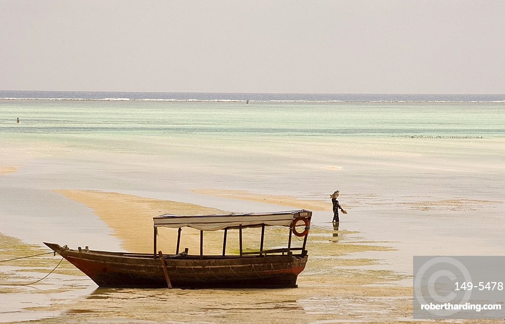An old wooden boat in the sea at low tide, Paje, Zanzibar, Tanzania, East Africa, Africa