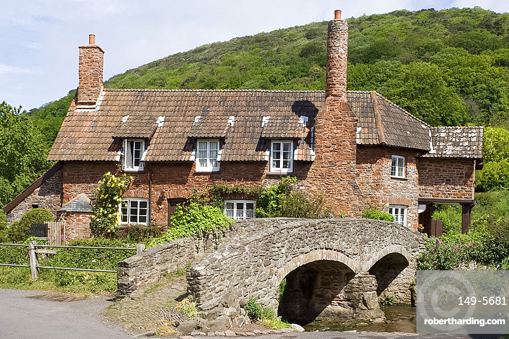 An old stone house with round chimney and stone bridge in Allerford, Exmoor National Park, Somerset, England, United Kingdom, Europe