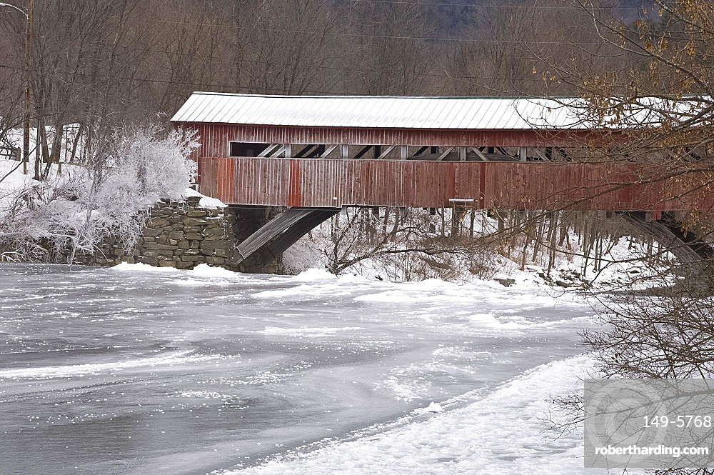 A red covered wooden bridge in Taftsville, Vermont, New England, United States of America, North America