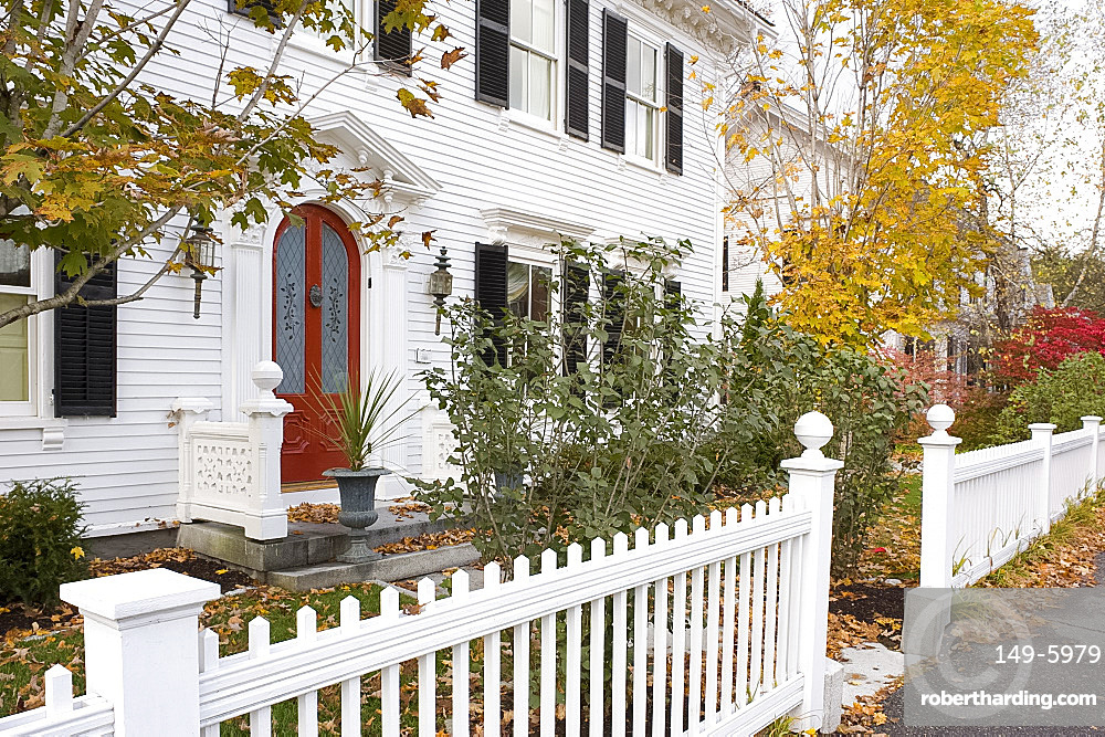 A traditional wood house and picket fence surrounded by autumn leaves in Woodstock, Vermont, New England, United States of America, North America
