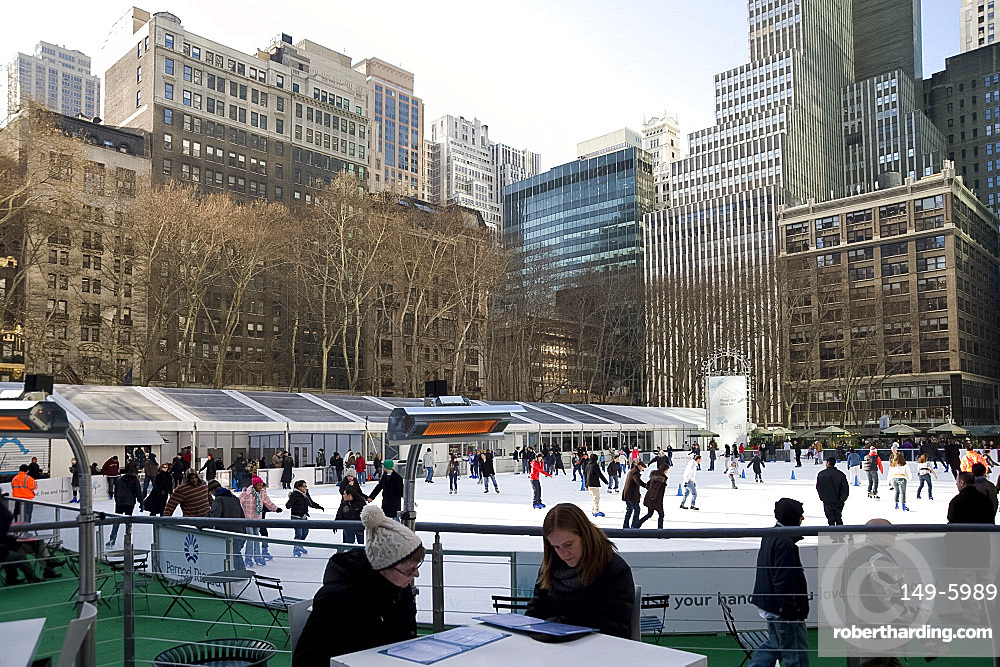 People sitting in a cafe next to the skating rink in Bryant Park, New York City, New York State, United States of America, North America