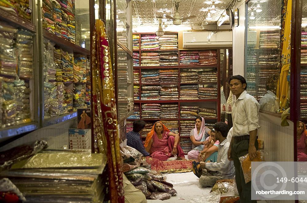People in a sari shop in Old Delhi, India, Asia