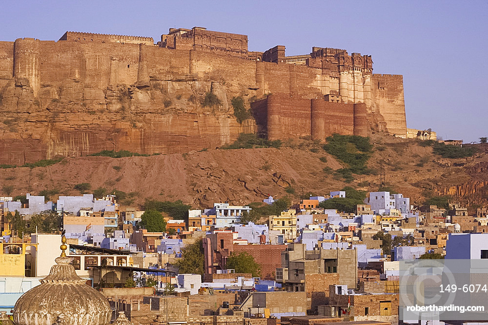 The Mehrangarh Fort on a hilltop overlooking the blue houses of Jodhpur, Rajasthan, India, Asia