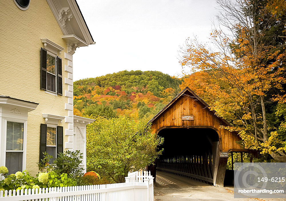 Middle Bridge, a covered wooden bridge surrounded by autumn foliage in the scenic town of Woodstock, Vermont, New England, United States of America, North America