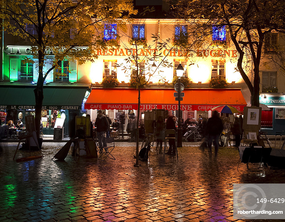 Restaurants and cafes lit at night in the Montmartre area of Paris, France, Europe