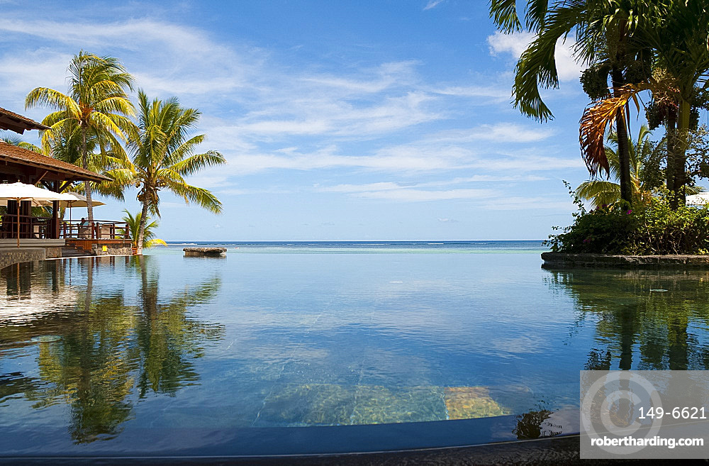 An infinity pool facing the sea at the Lux Le Morne Hotel on Le Morne Brabant Peninsula in south west Mauritius, Indian Ocean, Africa