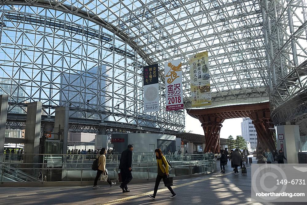 A wooden gate and steel and glass roof at the east entrance to the Kanazawa JR railway station, Kanazawa, Ishigawa, Japan, Asia