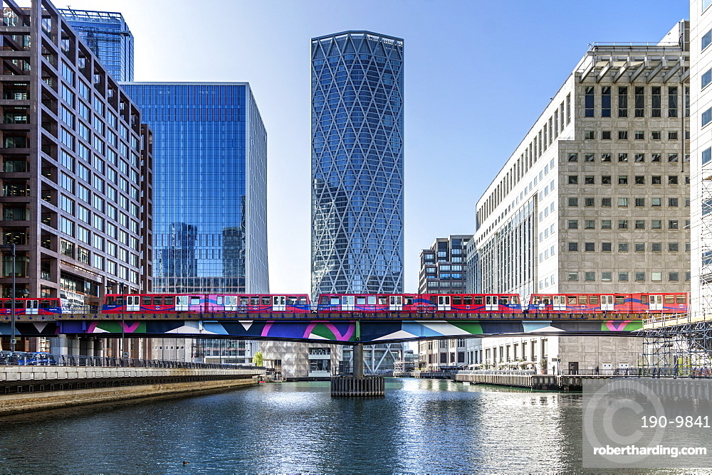 Dockland Light Railway (DLR) train crossing Middle Dock at Canary Wharf, Docklands, London, England, United Kingdom, Europe