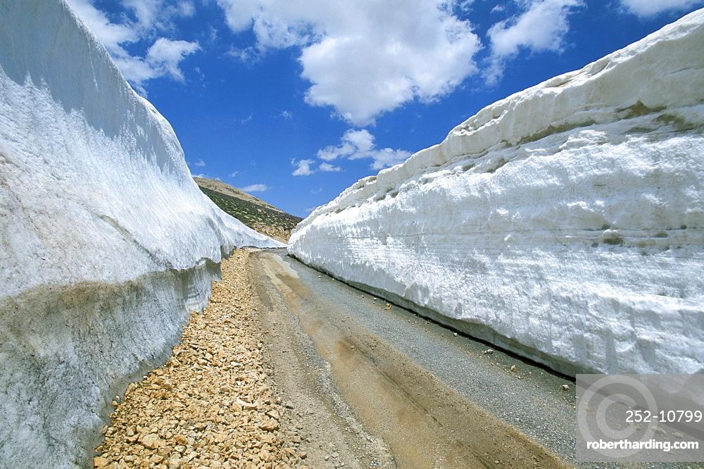 Spring snow on road crossing the Mount Lebanon range near Bcharre, Lebanon, Middle East