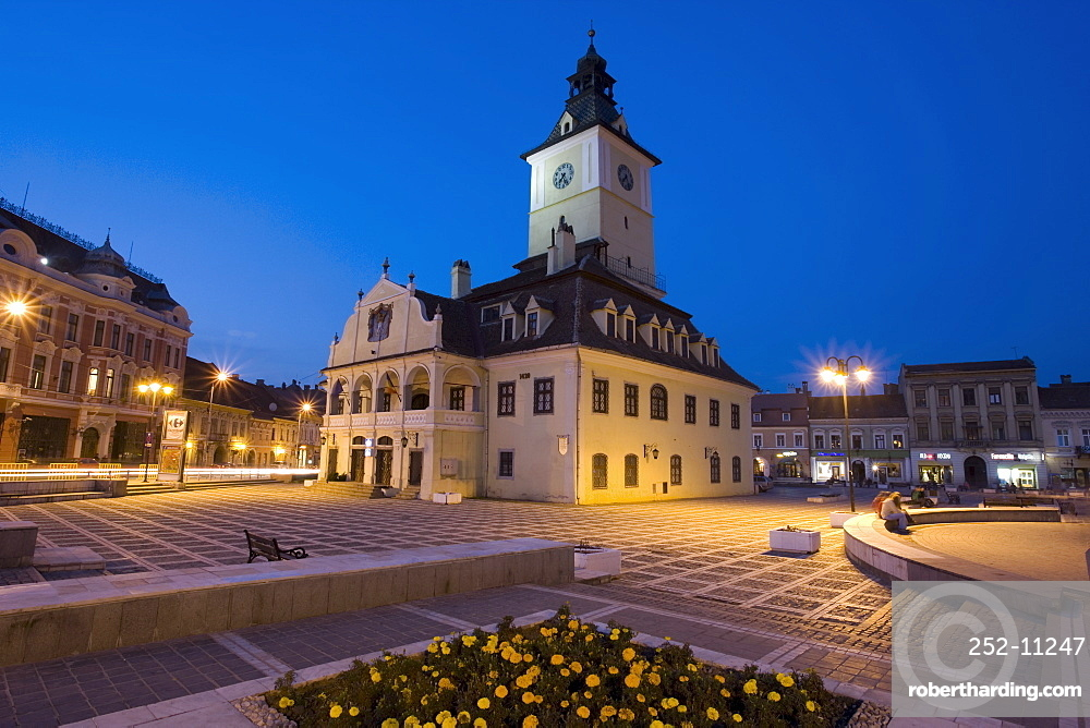 The Council House (Casa Sfatului) dating from 1420 topped by a Trumpeter's Tower, the old city hall now houses the Brasov Historical Museum, illuminated at dusk, Piata Sfatului, Brasov, Transylvania, Romania, Europe