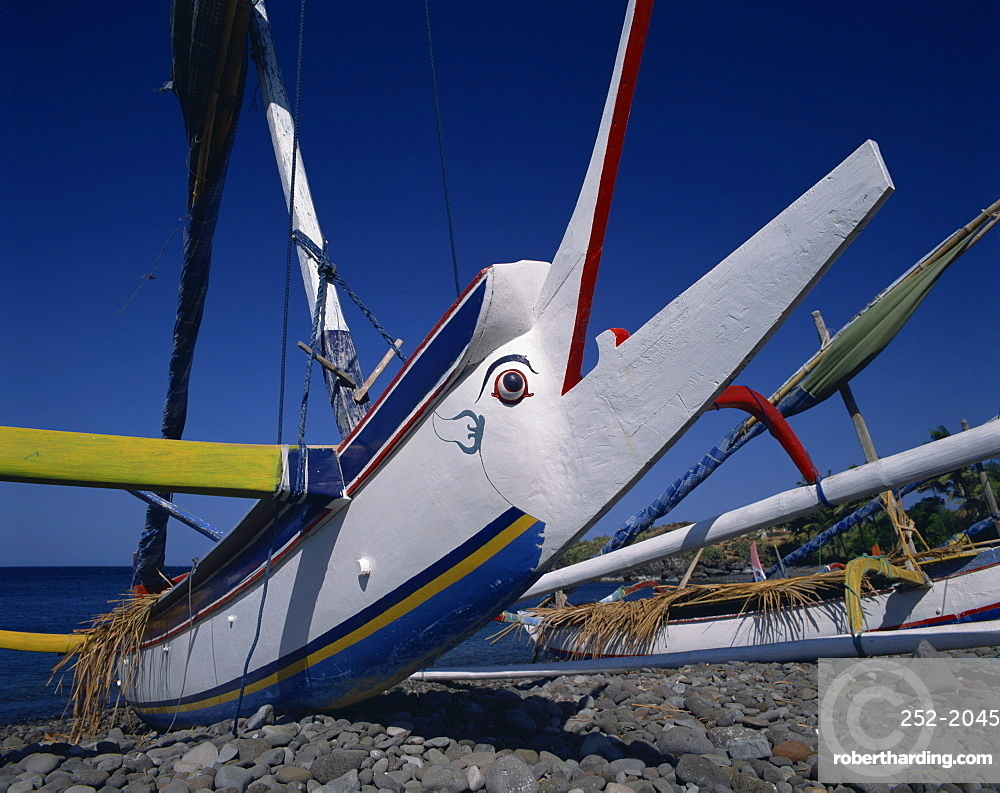 Close-up of the prow of an outrigger fishing boat on the beach in Bali, Indonesia, Southeast Asia, Asia
